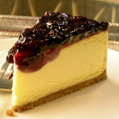 Blueberry topping on cheese cake slice